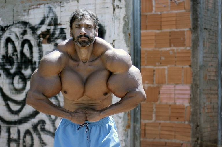 *** EXCLUSIVE - VIDEO AVAILABLE *** SAO PAULO, BRAZIL - SEPTEMBER 18: Valdir flexes in the street on September 18, 2015, in Sao Paulo, Brazil. An incredible Hulk-inspired bodybuilder is risking his life to pump up his muscles by injecting oil into his arms. Beefcake Valdir Segatoís huge biceps measure a staggering 23 inches as a result of painful synthol injections.The 48-year-oldís arms have doubled in size from 12in after he began injecting the potentially lethal oil substance five years ago - and now he wants to get even bigger. Valdir, from Sao Paulo, Brazil, is inspired by the physiques of Arnold Schwarzenegger and the Hulk and is proud to be known locally as ëHe-Maní and 'the monsterí in the street. PHOTOGRAPH BY Guilherme LaMotta / Barcroft Images London-T:+44 207 033 1031 E:hello@barcroftmedia.com - New York-T:+1 212 796 2458 E:hello@barcroftusa.com - New Delhi-T:+91 11 4053 2429 E:hello@barcroftindia.com www.barcroftimages.com